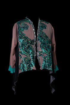 This is a favorite sheer swing jacket because itfeels so nice to wear and has both brown and black in the featured print, allowing it to be worn witha wide range of things. The burn-out silk vel...