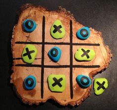 Made this outdoor tic tac toe board out of a Piece of cut tree stump and I painted some rocks for the X's and O's.