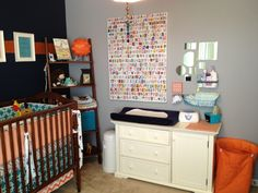 Short on space? We love the idea of storing changing table supplies in baskets on the wall. #nursery #organization