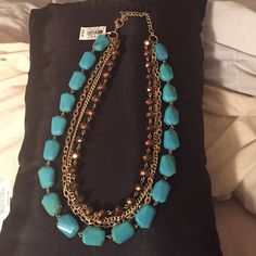 """Stunning!! Turquoise Stone Four Strand Necklace Absolutely Stunning 4 strand Necklace with Turquoise stones and Gold chains. Approximately 10""""long Jewelry Necklaces"""
