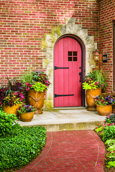 Use colorful urns that enhance the outside colors of your home!