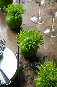 DIY Apple Bombs by cfabbridesigns: Acid green Spider Mums are placed in green apple vases for an explosive centerpiece. #DIY #Flowers #Apple_Bombs