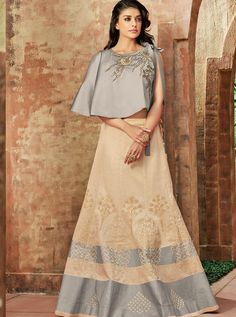 You'll fall head over heels for this mesmerizing cream color silk fabric zari and sequins embroidery party wear lehenga. Drape this lehenga at your upcoming ethnic functions with the matching traditional jewelry for a gorgeous look. Lehenga Choli Designs, Ghagra Choli, Lehenga Choli Online, Silk Lehenga, Lehenga Blouse, Silk Dupatta, Anarkali, Western Lehenga, Indian Bridal Lehenga