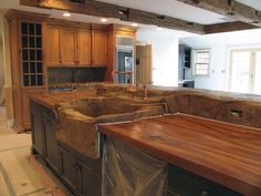 wood look concrete countertops.  Sink kinda looks like something from The Flintstones, but love the countertops.