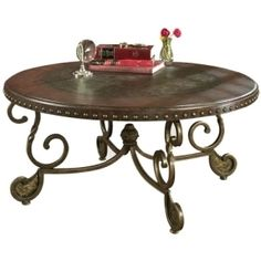 """Ashley Furniture Rafferty 42"""" Round Coffee Table - Old World Design, Wood and Metal. Available at TotalHomeSupply.com"""