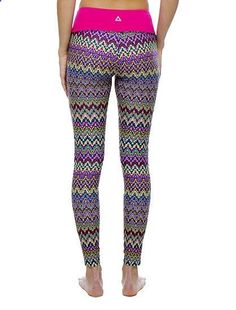Gear Gone Wild: 10 Pairs of Printed Workout Pants: Im in love with these jacquard leggings ($84) from Prismsport. Between the wide pink waistband, flattering ankle length, and tiny key pocket, you just cant go wrong with these wild things.