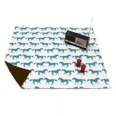 Horse print picnic blanket.