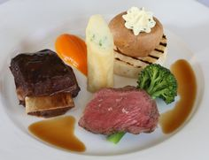 2014 #YorkshireLife Food & Drink Awards, Rudding Park, #Harrogate. #Main Yorkshire #Beef;  Roast Sirloin and Short Rib, Crispy Potato and Chive Spring Roll, Carrot and Cumin Puree with Purple Sprouting Broccoli and Jus.