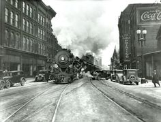 Historic Photo from the 1930's - A Hudson locomotive makes it's way down the middle of West Washington St. in downtown Syracuse (early 1930's). Syracuse Newspapers file photo