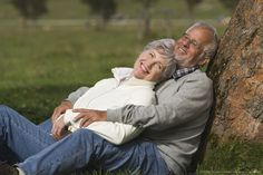 Austria, Karwendel, Senior couple in the countryside, embracing