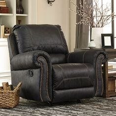 It's+all+in+the+details.+And+the+Milhaven+Rocker+Recliner+by+Signature+Design+truly+nails+it+with+fashion+forward+elements+including+a+picture+frame+bustle+back,+nailhead+trim,+padded,+rolled+arms+and+overstuffed+cushions+throughout.+Contrast+overstitching+gives+this+piece+the+presence+to+sit+comfortably+in+the+living+room+or+family+room+while+faux+leather+upholstery+stands+up+to+your+lifestyle+with+ease.