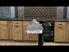 Custom Amish Cabinetry display in rustic hard maple with panel ready fridge and gold and blue accents. Installed in the Village Home Stores showroom. At Home Store, Blue Accents, Cabinet Design, Amish, Showroom, Kitchen Cabinets, Appliances, Display, Rustic