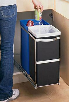 The dual-bucket simplehuman Pull Out Recycler slides out of sight beneath a kitchen counter.
