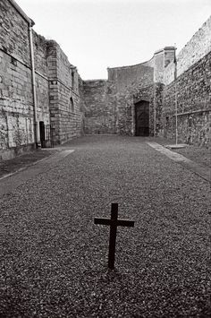 Kilmainham gaol (now a museum)- The small cross marks the spot where our (majority of our leaders were executed ,with the exception of Thomas Kent (executed in a military barracks in Cork) and Roger Casement in an English prison. Roger Casement, Ireland 1916, Irish Independence, Kilmainham Gaol, William Butler Yeats, Easter Rising, Nobel Prize Winners, Irish Roots, Irish Eyes