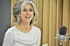 Beautiful natural grey hair. This woman looks sophisticated and stylish and not 'old' at all showing that grey hair does look beautiful on women.