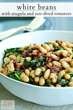 White beans with arugula and sun-dried tomatoes uses canned beans for a time-saving shortcut. This tasty, vegan side dish is ready in five minutes. #beanrecipes #veganrecipes #sidedishes #weeknightdinner #easysides Vegan Side Dishes, Side Dish Recipes, Vegetable Dishes, Veggie Recipes, Food Dishes, Whole Food Recipes, Vegetarian Recipes, Cooking Recipes, Dinner Recipes