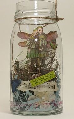 Fairy girls in a jar.  I want to make something like this, but w/ photos of my kids.