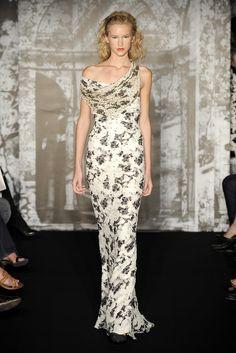 5c1540b1b1 Carolina Herrera Resort 2010 Fashion Show - Eniko Mihalik Floral Sheath  Dress