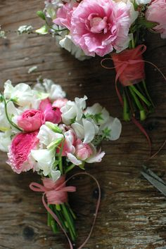 pink bouquets, actually, these are not your normal bouquet , but more of a posie, interesting , that's what I was thinking would be a cool favor for the women,!