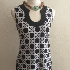 Special!$!Black House White Market Dress/Tunic Versatile black and white sleeveless dress. Can wear as a mini or as a tunic over jeans or leggings. New condition. Cute and is stretchy.Bundle and save even more$! Black House White Market Dresses Mini