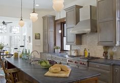 my perfect kitchen finish wise- gray cabinets, gray soapstone countertops, white subway tile backsplash, red accents. ADORE