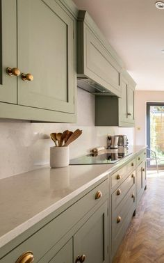 Beautiful light and airy green kitchen featuring Quartz worktops and burnished brass Armac Martin knobs and cup pull handles. Sage Kitchen, Green Kitchen Cabinets, Gold Kitchen, Kitchen Redo, Kitchen Living, New Kitchen, Kitchen Remodel, Light Green Kitchen, Cheap Kitchen