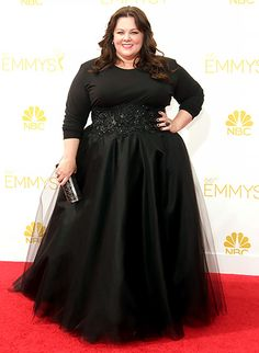 Melissa McCarthy  2014 Emmys The nominee wore a black top with a custom  Marchesa skirt 4689137de617