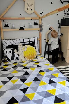 Perfect for your monochrome super hero themed nursery, this handmade baby quilt features a modern black , yellow, greys and white triangle pattern exclusive to NotSewStrange. Made from 100% cotton fabric, it is machine quilted following the triangle pattern. Completely reversible, the back of the quilt is a black and white crosshatch print. Each side of this soft and warm quilt is a solid piece of fabric (this is not a patchwork quilt) with batting sewn securely in the middle. It looks…