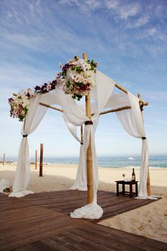 white draped wedding ceremony arch beach weddings wooden floors los cabos