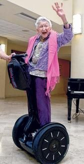 102 yrs young + segway = My Grammy! Where are the side pockets and cup holder?