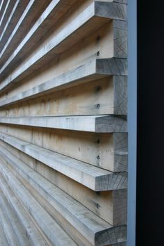 these wood slats are utilitarian in the way they are connected to the substrate — countersunk screws — but note the care in angling the top of the projecting pieces, so water sheds off the wood. contemporary exterior by Fougeron Architecture FAIA