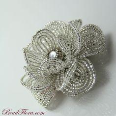 French Silver Goddess beaded flower hair clip-- member of the artisan group. $65.00, via Etsy.