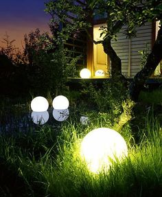 """Outdoor LED 16"""" Round Ball with Remote Control by Design KollectionLLC. $175.00. Completely Waterproof. Comes with Remote Control. Rechargable. Can sit on the ground or float in water. Choose your color or have it change automatically. This 16"""" Round LED ball is - just like our Light Cube - made from a very strong material which allows it to stay outside in any weather.  It plugs into a charger charge, and after charging it can then be placed where needed, or stay plugge..."""