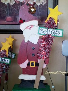 Cute Wood Craft Santa holding a star stick that lights up. By Carousel Crafts