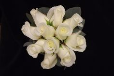 Bridesmaids hand tied of simple white roses with a eucalyptus edge  www.weddingflowersbylaura.com