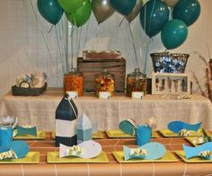 The fishing theme birthday party is adorable! Love the blue and gray color palette.