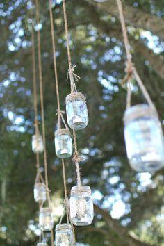 Mason Jar lighting in oak tree