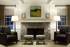love the fireplace stonework, chairs, windows...by ML Interior Design