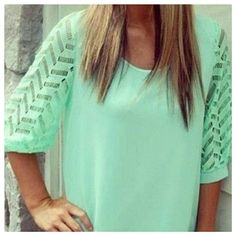 """Mint Green Blouse. Print. Open Back. Beautiful Summer blouse. NWOT. Half open back. Lined. 1/2 sleeves. No inner tags but mostly fully polyester or a blend of it. Labeled as an XL but more like a Medium. Please compare measurements to your favorite blouse.  Length: 24 3/4"""" Armpit to armpit: 18.5"""" Waist flat: 19"""" Tops"""