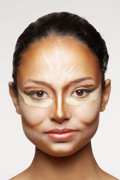Step 1: Use fingers to dab cream foundation that's one shade lighter than your skin tone on the center of your forehead and chin, down the bridge of nose, and on cheekbones. Apply a base that's two shades darker below the cheekbones and jawline, along the sides of the nose, and at the temples.