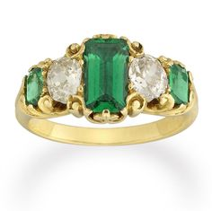A late Victorian emerald and diamond five-stone ring    A late Victorian emerald and diamond five-stone ring, the ring set with three emerald-cut emeralds, estimated to weigh a total of 1.30 carats, alternately-set with two old-cut diamonds, estimated to weigh a total of 0.80 carats, all claw-set to an ornate yellow gold scroll motif mount, to a tapered D-section fluted shank, gross weight 5.5 grams, circa 1880.