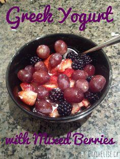 Plain fat-free Greek yogurt with mixed berries -- strawberries, blackberries, blueberries and grapes. Yum! Free 7-day clean eating challenge at ElisesChallenge.com