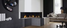 Brilliant Modern Electric Corner Fireplace Design With Black Glass Panels Also Cool Rounded Table And Modern Grey Fabric Sofas In Open Floor Interior Ideas Fireplace Design, Gas Fireplace, Fireplace Ideas, Minimalist Sofa, Design Salon, Rustic Fireplaces, Fireplace Modern, Living Room Lighting, Modern Decor