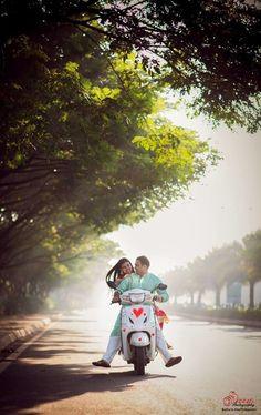 romantic shot, couple on a bike