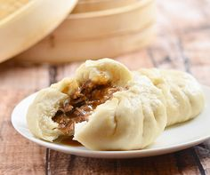 Siopao Asado are steamed buns filled with shredded pork cooked asado style