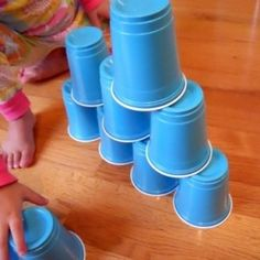 "It's like ""Minute to Win It"" at home! Stack cups. Can your kids use both hands? Great for brain development. :)    #play #children #kids"