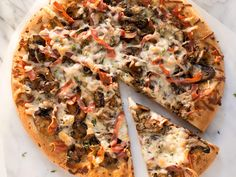 Mushroom-Prosciutto Pizza | Thick crust or thin, veggies or meat toppings, we've got the perfect healthy pizza recipes to please your palate -- plus tips and tricks for saving time, cutting calories, and maximizing nutrition.