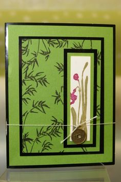 handcrafted card ... green with black mats and ink ... bamboo ... Asian theme ...