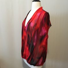 "Cynthia Steffe Pleated Sheer Red Printed Blouse 🌺4/25 Work Week Chic Host Pick @healchno 🌺 Bold print with pink and black accents on a rich red background. Chiffon, loose fitting Draped V-neck with pleated details, extended sleeve cap with elastic hemline. 100% poly Machine washable 48"" bust 25"" overall length Cynthia Steffe Tops Blouses"