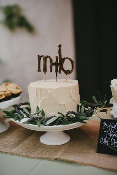 A Petite Wedding Cake with a Woodsy Monogram Cake Topper and Leafy Decor | Vitaly M Photography | See More! http://heyweddinglady.com/histor...
